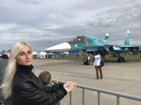 tourist near Sukhoi jet fighter